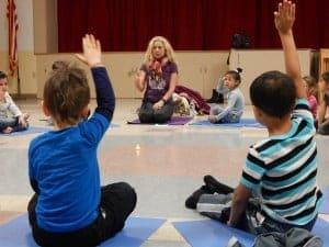 kids learning yoga - teaching children meditation