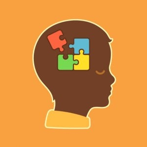 child head profile silhouette with jigsaw puzzle symbolizing autism spectrum disorders