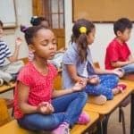children in classroom mindfulness meditation