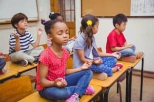 kids meditating on their desks in school