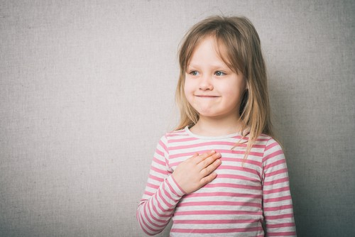 little girl touching heart - free heart meditation