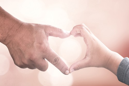 hands touching to make a heart - child mental health and meditation