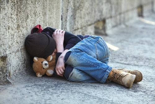 child sleeping on street - giving to charity