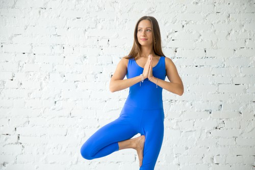 tree pose - yoga teacher