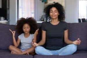 mum and child meditating