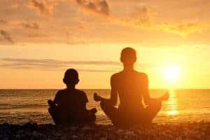 boy and mum meditating - teach children meditation